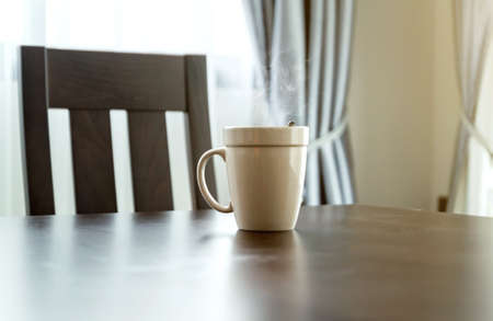 White coffee mug Placed on a wooden desk in the morning. concept relax in the morning with coffee Favorite Cup