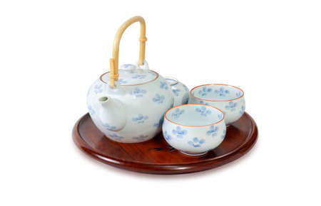 Ceramic teapot and cup set isolated on a white background. Standard-Bild