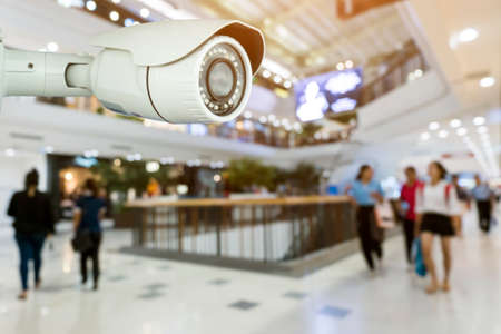 CCTV security with shop store blurred background. Abstract blurred department store Standard-Bild