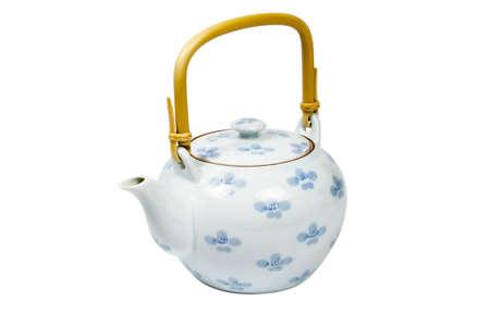 Closeup of tea set on white background.