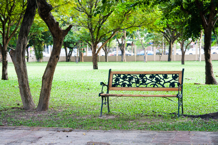 trafic: relaxation empty wood chair in park and trafic jam background Stock Photo