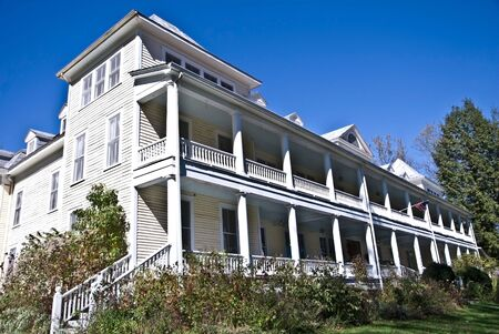 View of the front of the Balsam Mountain Inn, a 100 year old structure that's a bed and breakfast hotel. Three stories full of period furnishings.