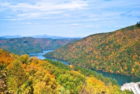 An autumn mountain landscape with a lake in the valley. A view into Lake Tugaloo from the dam at Lake Yonah in North Georgia. photo