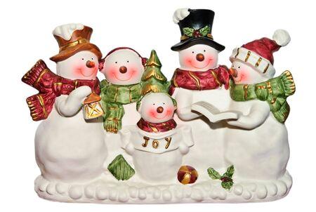 carols: Cute happy snowmen and women and children figurines singing Christmas carols.