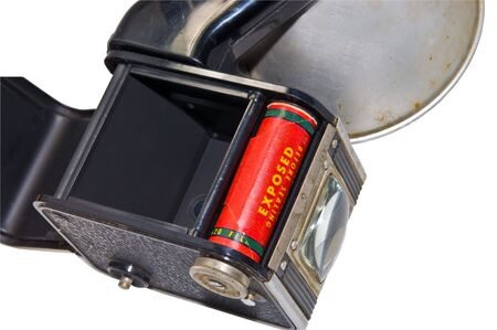 An old camera with the flash on the side. The back is open showing film inside.  Some day I'll have it developed. 版權商用圖片