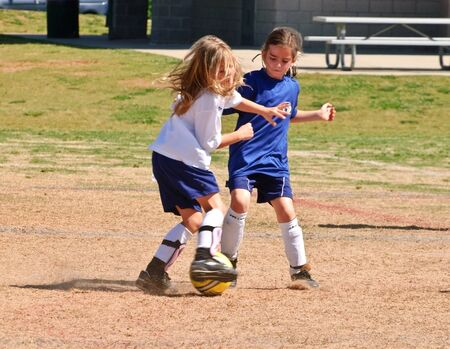 junior soccer: Forsyth County, Cumming Georgia -  May 8, 2010-Young girls fighting for the ball during a soccer game. A regular season game of girls 8 and under. The Fusion Fury vs the Cheetahs.