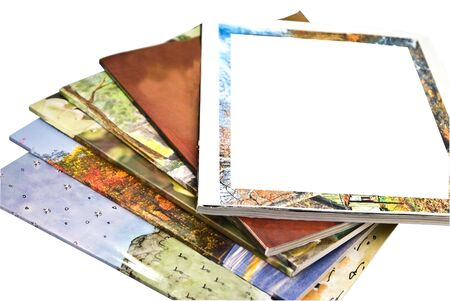 A stack of colorful magazines, isolated, with copy space on the cover of one. photo