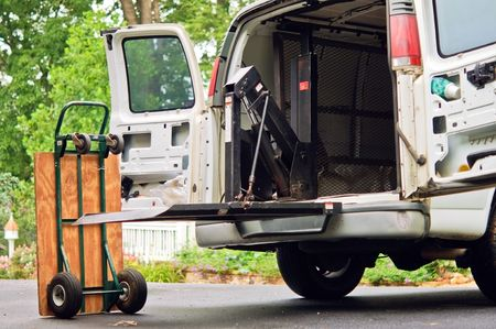 handtruck: A small delivery truck, with equipment, in a driveway. Stock Photo