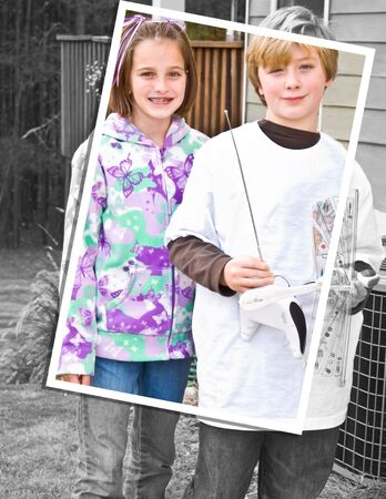 Frame within a photo style image of a young girl and boy. He's holding a remote control airplane. 10 years old Stock Photo - 7473750