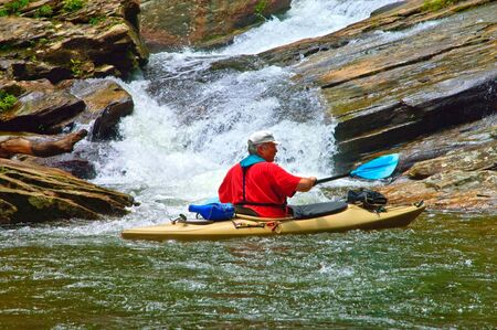 Close view of an older man looking at a waterfall on Lake Jocassee in South Carolina. Stock Photo