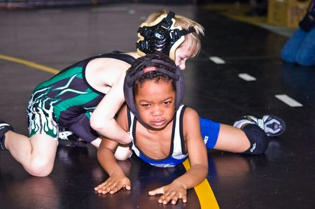 Marietta, Georgia, Sprayberry Highschool - January 24, 2010 - Two very young boys during a wrestling tournament. They are in the 6 year old age group. This was the Cobb County Invitational Wrestling Tournament. The caucasian boy won.