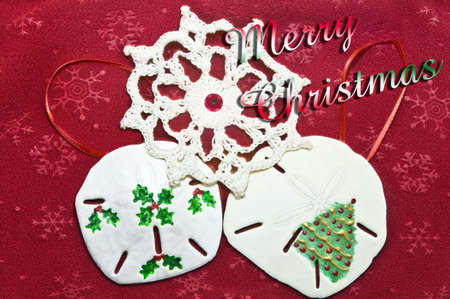 Christmas tree decorations on red fabric with text. Stock Photo - 7728737