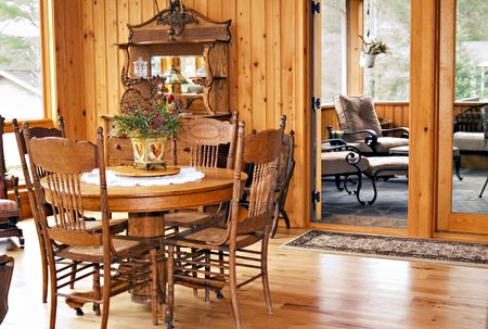 paneling: A greatroom with views of the dining, and screened porch areas.