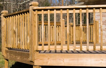 hardscape: Close-up of the outside angles of a wooden deck. Useful to homebuilders and landscape planners.  Stock Photo