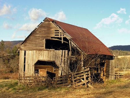old farm:  A old barn in a late winter evening.