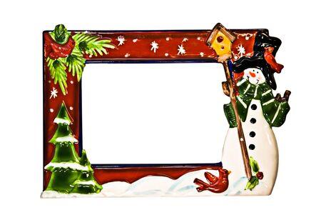 A decorative ceramic Christmas frame with snowman.