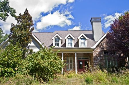 A large, modern, house that has been abandoned and is in foreclosure.