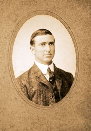 An original vintage photograph of a gentleman in coat and tie. photo