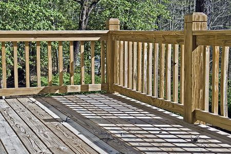 Corner shot of a wooden deck in summer, useful for design or construction concepts.
