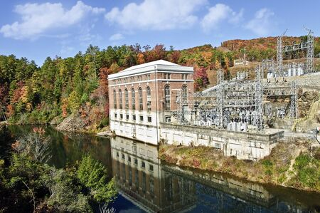 safe water: A large hydroelectric power plant on a river with the autumn colors around it. Safe, clean and green, water power generated in Georgia.