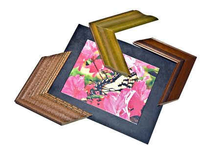 A canvas print, mat and three wooden frame corners. photo