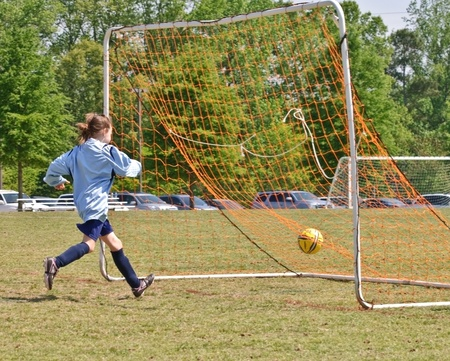 missed: Cumming, GA, USA - April 17, 2010 - The young goal keeper missed a ball and the opposition made the score in Forsyth County, Cumming GA, April 17, 2010.