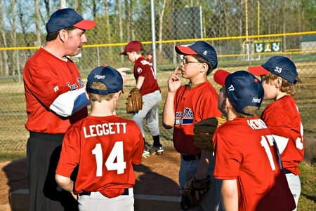 Cumming, GA, USA - April 17,2009 : A coach gving last minute instructions to his team before a game, Forsyth County, Cumming, GA, April 17, 2009, Sawnee Mountian team, the Braves. Editorial