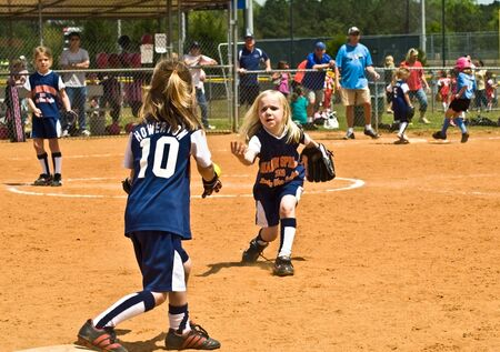 Cumming, GA, USA - April 18, 2009 :  Making a play to get the runner out during a softball game in Forsyth County, Cumming, GA, April 18, 2009.A regular season game, the Sharon Springs War Eagles vs the Blue Thunder. Editorial