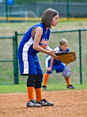 Cumming, GA, USA - April 18 : Young girls (8 years old) playing their positions during a softball game. Forsyth County, Cumming GA, April 18, 2009, a regular season game of the Lady Gators vs the Bennet Park Blues. Stock Photo - 8944910