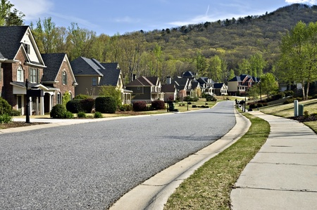 suburban: Cumming, GA- USA- April 7, 2011-Sidewalk and street of an area in Cumming, GA,  A beautiful modern  residential neighborhood.