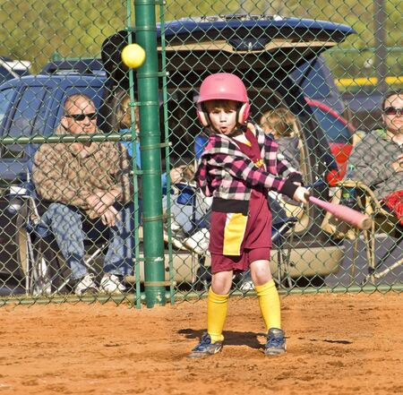 Cumming, GA, USA; April 16, 2011  - A young girl during a softball game in Forsyth County, Cumming GA, making a hit; a cute surprised expression on her face.  A regular season game between the Diamonds and the Warriors.