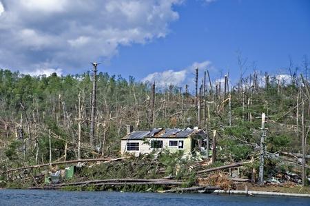 extensive: CLAYTON, GA, USA - APRIL 28 :  Tornado damage on Lake Burton on April 28, 2011, in Rabun County, Clayton, GA, USA.  Extensive damage to many large homes and boathouses. Editorial