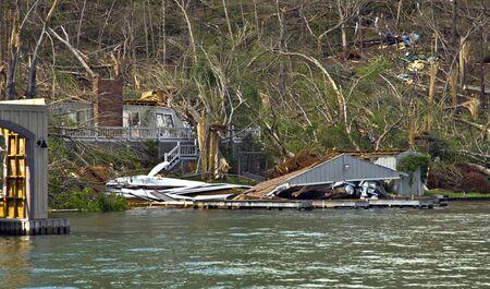 extensive: CLAYTON, GA, USA, APRIL 28 :  Tornado damage on Lake Burton on April 28, 2011, in Rabun County, Clayton, GA, USA.  Extensive damage to many large homes and boathouses. Editorial