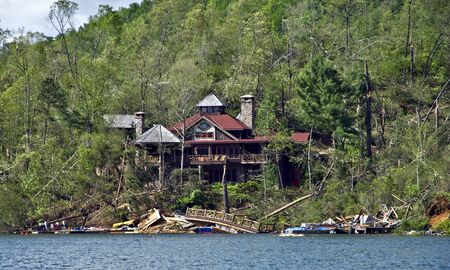 CLAYTON, GA, USA, APRIL 28 :  Tornado damage on Lake Burton on April 28, 2011, in Rabun County, Clayton, GA, USA. This house was spared while the area on the lake was demolished. Stock Photo - 9433701