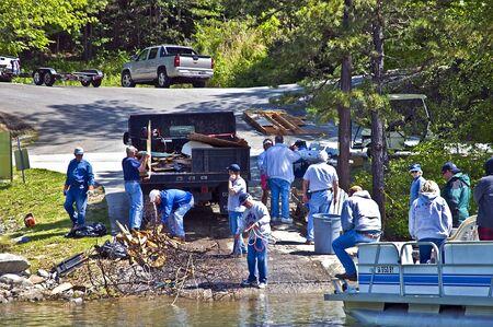 CLAYTON, GA - MAY 6 : A group of volunteers cleaning tornado debris, May 6, 2011, Rabun County, Lake Burton, Clayton, GA, the worst tornado to ever hit the area.