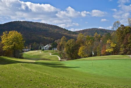 Autumn colors surrounding a mountain golf course. photo