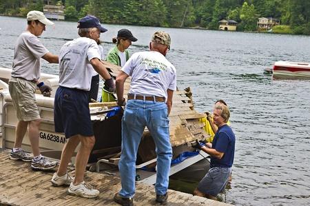 CLAYTON, GA USA - JULY 16:  Cleaning up debris on July 16, 2011 in Lake Burton, Clayton, GA.