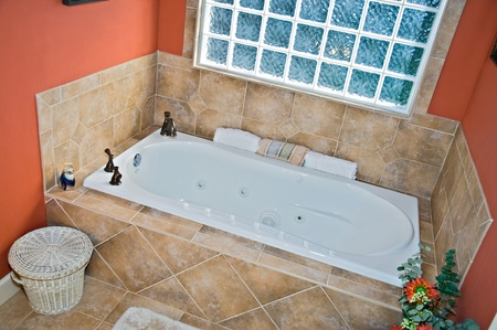 bathroom tiles: Modern colorful bathroom tub area.