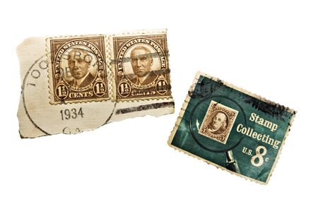 Three stamps from a collection.  One from the 1934 era and one commemorating stamp collectors. Stock Photo - 10042997