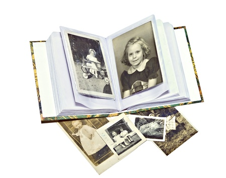 vintage photo: A photo album with old pictures of family members. Stock Photo