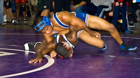 submission: Atlanta, Ga USA - December 28, 2009 - Two African-American boys wrestling at the Dixie Nationals Championship in Atlanta GA. These 2 are in the over 14 highschool division.