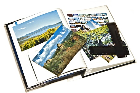 photo album book: Photos from travels being organized to put into a scrapbook.