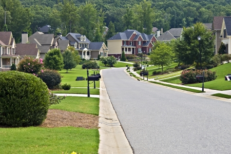 residential neighborhood: A street on a quiet day in a suburban neighborhood.