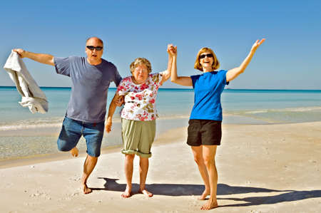 A family of different generations having fun on the beach. photo