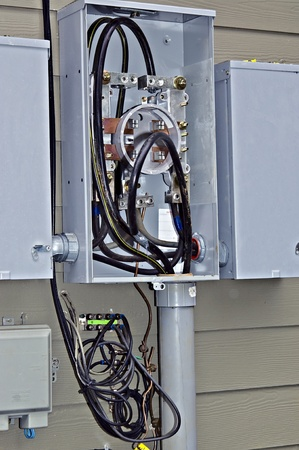 electrical contractor: Inside of an electrical box that is being repaired or installed. Stock Photo