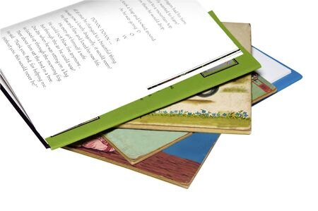 one story: Old story books with a new one on top opened to a story page.