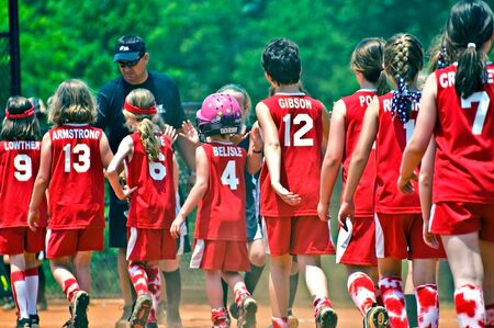 congratulating: CUMMING, GA, USA - MAY 21: The game is over and the two teams are congratulating each other for playing well. May 21, 20ll, Cumming GA, USA.