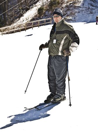 A man ready to hit the slopes for some fun  photo