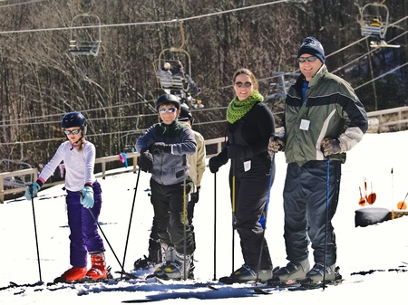 A family enjoying a holiday at the ski slopes  Stock fotó