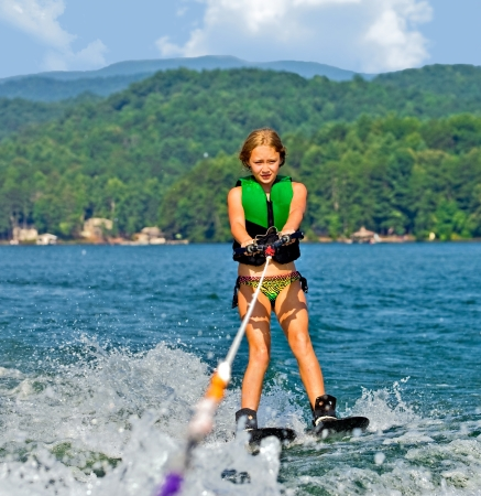 A young girl ready to cross a wake on trick skis